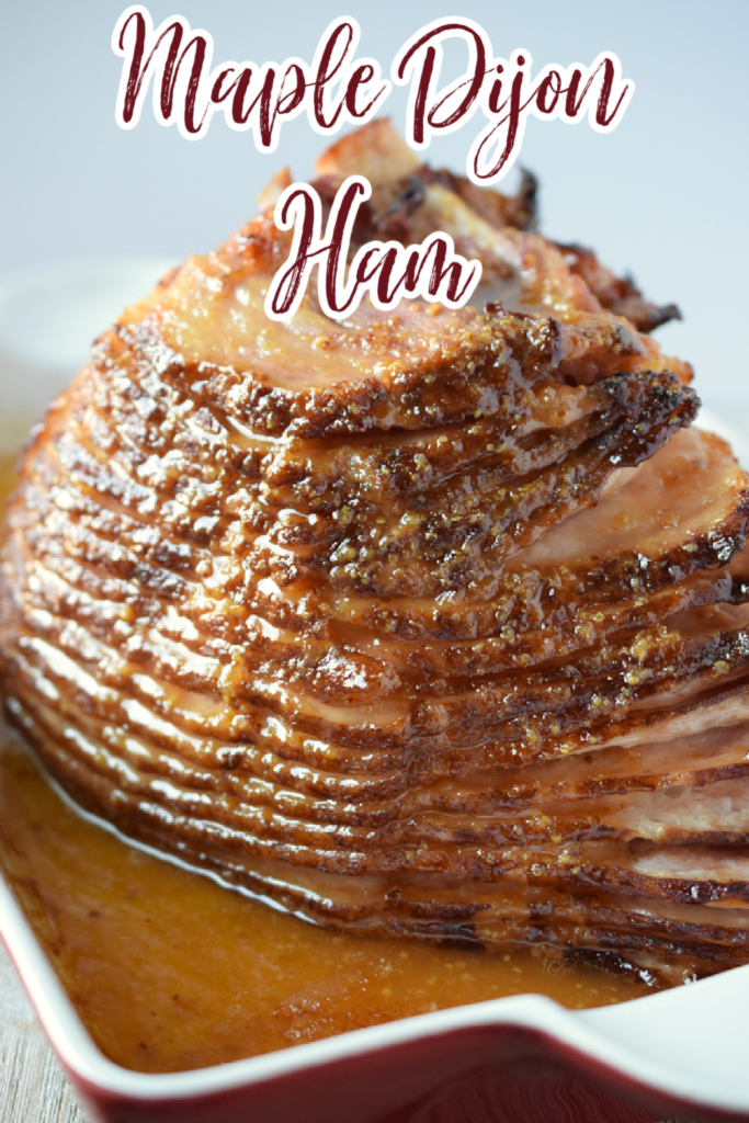Maple Dijon Ham - This is the perfect ham recipe for the holidays! Ham baked with a sweet and tangy maple and dijon mustard glaze. Holiday Ham Recipe | Christmas Ham | Thanksgiving Ham | Maple Ham